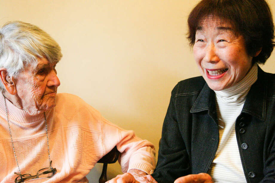 """Olive Dietsch, 99, and Shizuko Morishima, 72, from Japan, spend time together at Dietsch's Freeland home for the first time in 34 years. The two initially met as chaperones on a foreign exchange trip and describe their friendship as more like a family. """"I think the digital life has kept this strong,"""" Morishima said. Photo: Hilary Farrell   For The Daily News"""