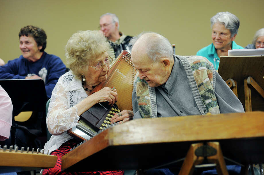 Bill Kuhlman, 96, on the hammered dulcimer and Jane Kuhlman, 95, on the autoharp, discuss the next song during the Jolly Hammer and Strings performance at the Chippewa Nature Center on May 17 in Midland. The Kuhlmans will be celebrating their 75th wedding anniversary on June 17th. Photo: Zack Wittman