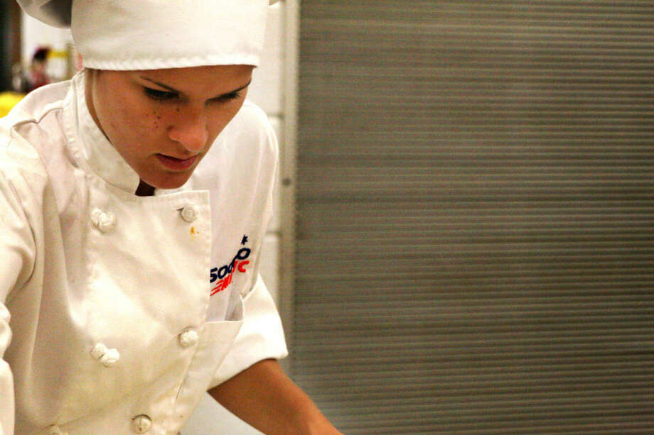 """Recent Saginaw Career Complex graduate Maria Buko, 18, practices for the upcoming SkillsUSA national trade competition. Buko, a two-time commercial baking state champion, placed fourth nationally last year. """"You see people in their veterinarian outfits, I'm in my chef uniform. You see welding guys walking by,"""" she said. """"It's just really fun."""" Photo: Hilary Farrell   For The Daily News"""