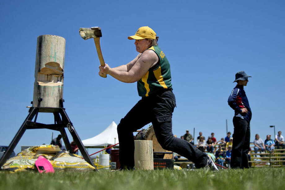 Australia's Amanda Beams competes in the standing block chop event during the Woodcutter's Ball Women's Professional Lumberjack Competition Saturday at Auburn City Park. Photo: NICK KING | Nking@mdn.net
