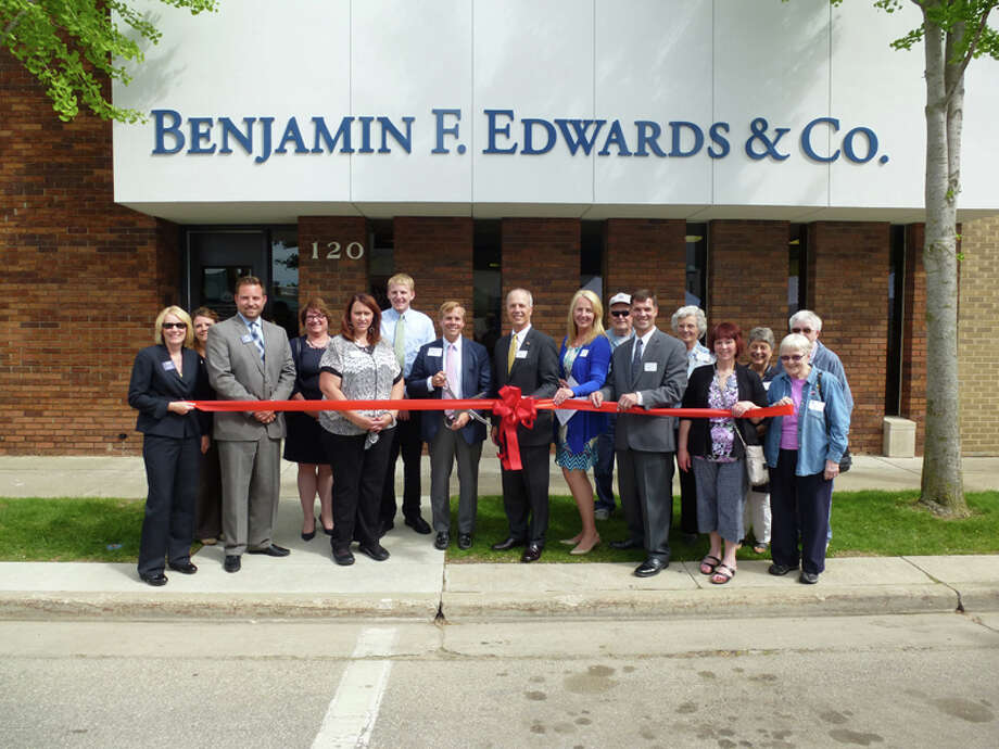 Benjamin F. Edwards & Co. founder and CEO Benjamin F. (Tad) Edwards IV, center with scissors, at the Midland Area Chamber of Commerce ribbon cutting. To Edwards' right, Midland office partners, Ralph Brozzo, Dana Gibbs and Matt Bishop. To left, Senior Registered Financial Associate Cathy Sasse. Photo: Photo Provided