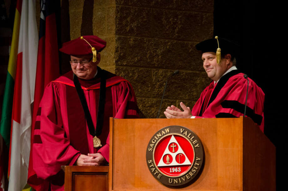 SVSU President Donald Bachand receives the presidential medallion from Board of Control Chairman Jeffrey Martin during the investiture ceremony at Saginaw Valley State University on Sunday. Bachand is the university's fourth president in its 50-year history. Photo: DANIELLE MCGREW