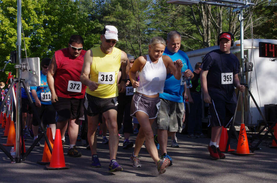 some of the entrants start the competitive 5K walk Saturday during the ninth annual Arc of Midland Stroll, Roll and 5K Run at Chippewa Nature Center. Top finishers in the walk were Rick Huber at 26:06.999 and Shelly Huber at 33:21.895. Approximately 240 people — up approximately 40 from last year — entered the competitive walk and the competitive run, an event organizer said. More participated in the Fun Walk. The Arc of Midland is a nonprofit organization promoting the general welfare of people with developmental disabilities. The fundraising event's presenting sponsor was Dow Corning Corp., and CherryBerry was the gold sponsor. Photo: Photo Provided
