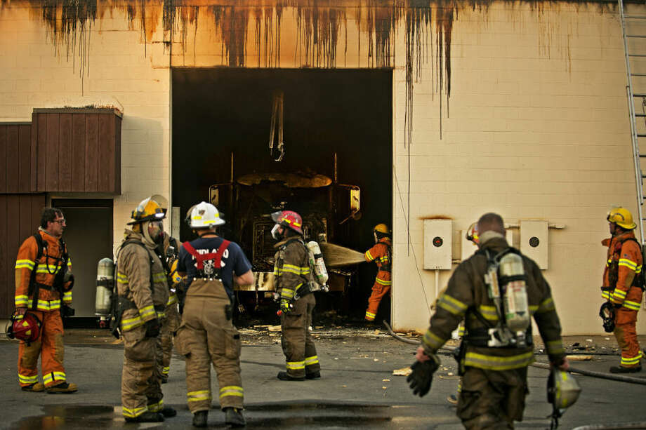 No one was hurt after a semi caught fire inside this commercial building on East Venture Drive off South Poseyville Road. Photo: SEAN PROCTOR | Sproctor@mdn.net
