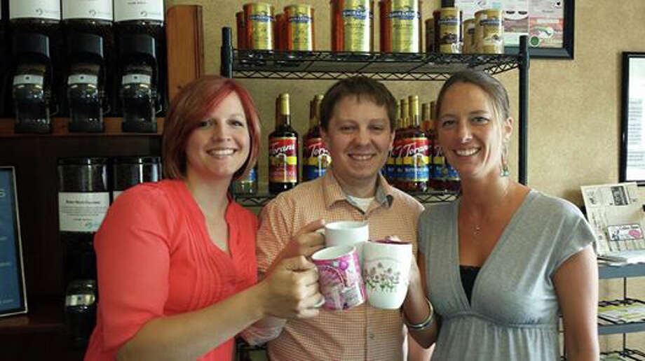 Photo provided The new owners of Grounds for a Better World coffee shops: from left, Tammy Wetteland, Nick Gillette and Tiffany Lintz. The three will take over from Dave and Jill Helgerson on July 1. The transition will allow the Helgersons to devote more time to their philanthropic interests.