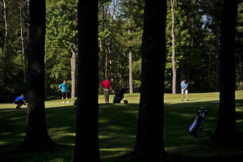 From left, Zach Ely, Justin Pahl, Mike Butzu and Daniel Bugosh finish up on hole 3 at Currie Golf Course. Photo: SEAN PROCTOR | Sproctor@mdn.net