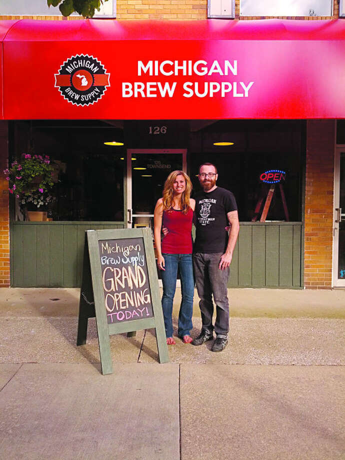FILE — Michigan Brew Supply co-owners Nicole van Schagen, left, and Matthew Kris during the grand opening of their retail store at 126 Townsend St. (Photo provided)