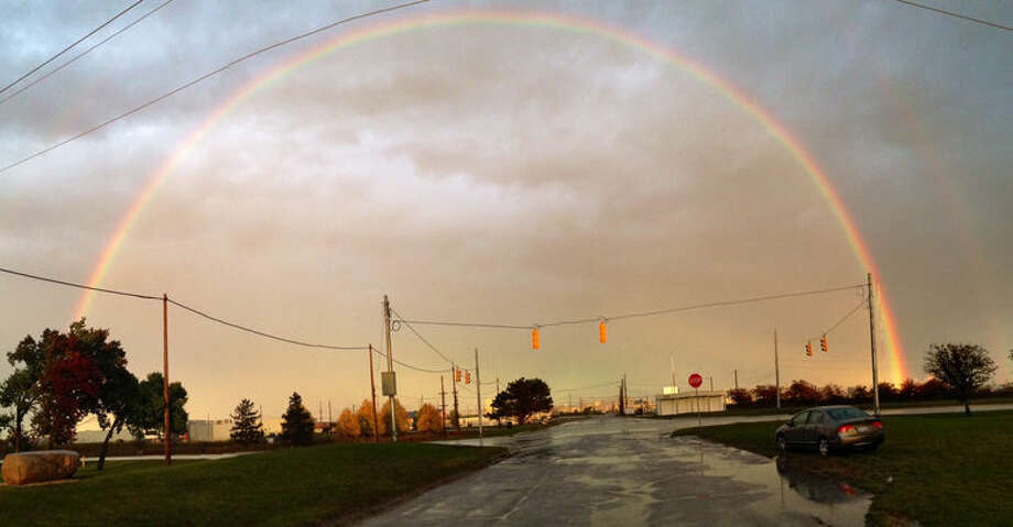 A rainbow shines over Dow Chemical as seen from Poseyville Road on Tuesday. The double rainbow was spotted by many in the Midland area just before sunset. Photo: ROBIN VERCELLINO | Photo Provided