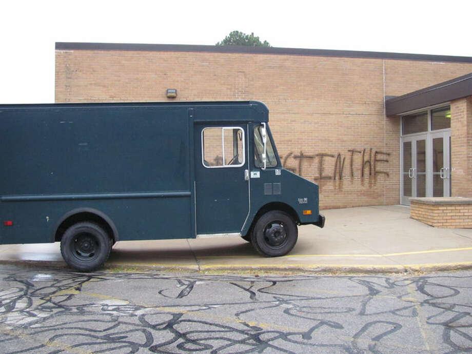 A Midland Public Schools work truck sits in front of the graffiti. Photo: Matt Woods