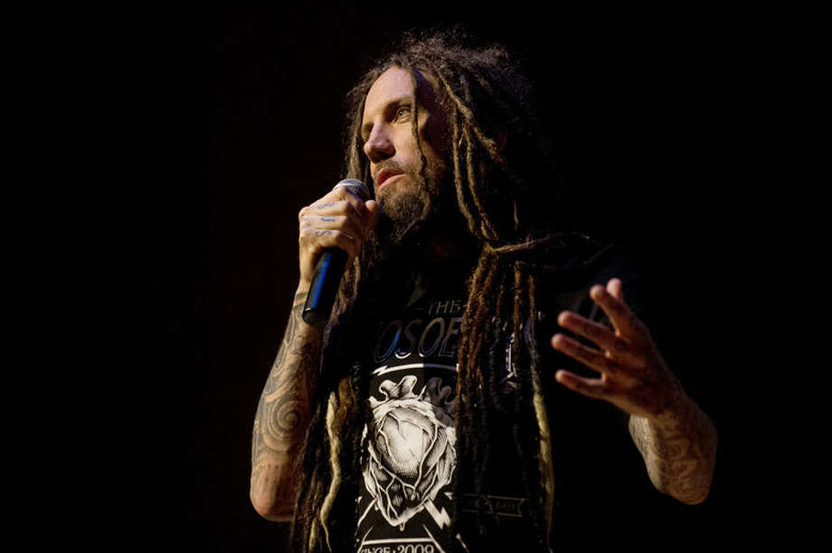 """Brian """"Head"""" Welch talks at Bullock Creek High School auditorium about his transformation from a drug addict to a follower of Jesus on Wednesday. Welch spoke openly about his band, Korn, and their rise to fame and his ensuing struggles with alcohol and substance abuse during his time in the band. Photo: Neil Blake/Midland  Daily News"""