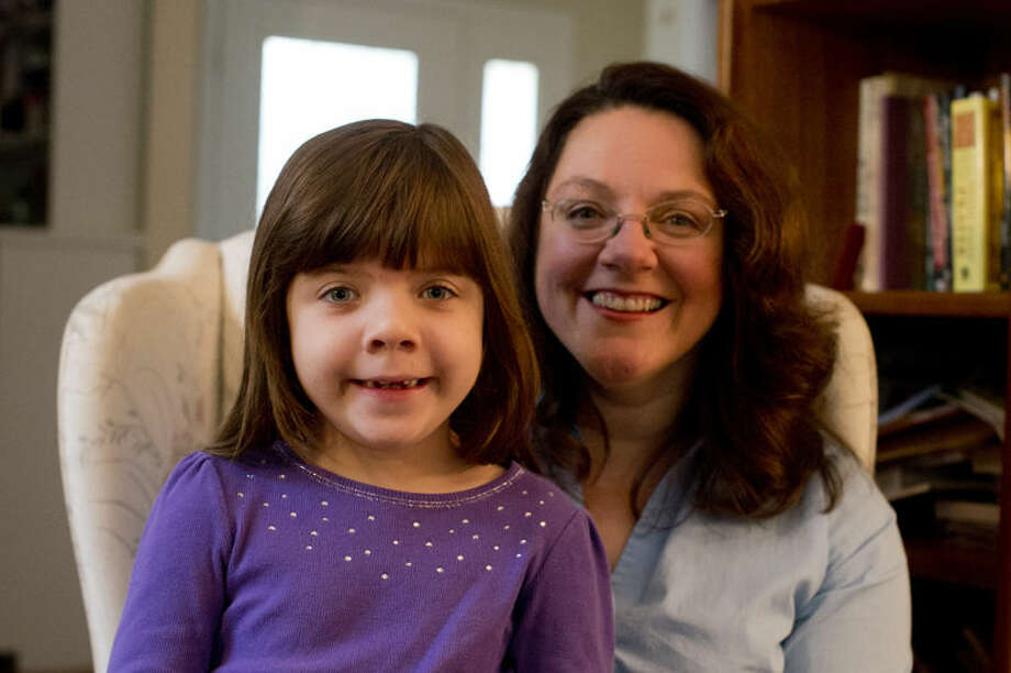 Mary Foerster and her daughter Kaydee, pose for a photo in their home in Midland. Kaydee grew up signing with her mother as another form of communication in addition to speaking. Mary teaches baby sign language as babies have the ability to sign before they can vocalize thoughts and ideas. Photo: Neil Blake/Midland Daily News