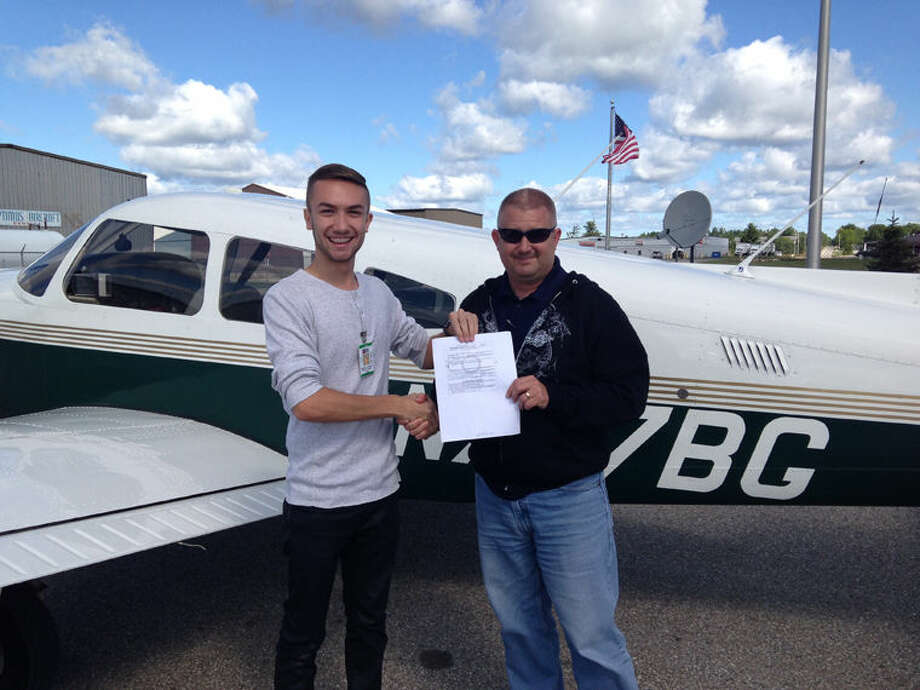 Kris Anderson is pictured with his designated pilot examiner, Kevin Spaulding. Photo: Photo Provided