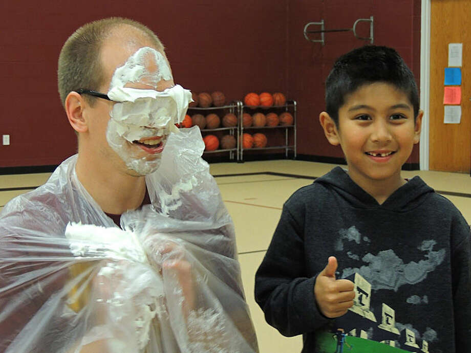 A student smiles after hitting Pastor Matt Makela in the face with a pie. Photo: Photo Provided