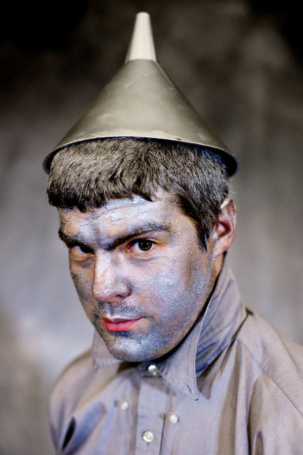 "Chase Brenske, a team leader with The ROCK Center for Youth Development, dressed as the Tin Man for ""An Evening in Oz"" at the Great Hall in Midland on Thursday. Proceeds from ticket sales went to support The ROCK. Photo: NEIL BLAKE 
