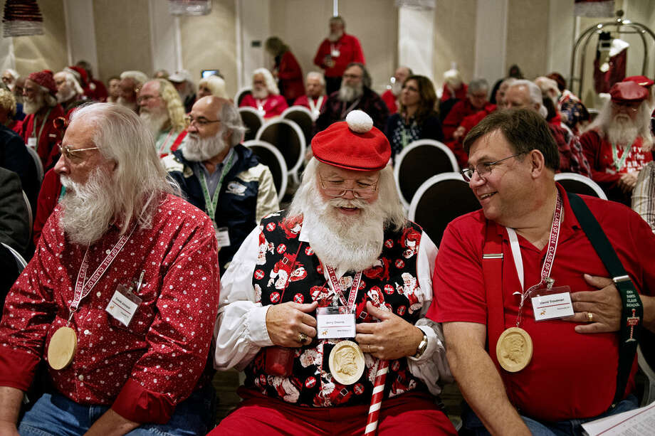 Jerry Owens, center, of New Albany, Ind., laughs with David Troutman, of Kenmore, N.Y., during a voice training seminar at the H Hotel during the Charles W. Howard Santa Claus School on Friday in Midland. Photo: Sean Proctor | Midland Daily News