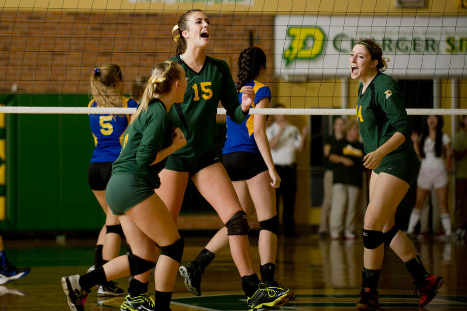 Dow High's Alyssa Stone, center, celebrates with her team at H.H. Dow High School on Tuesday. Photo: NEIL BLAKE | Nblake@mdn.net