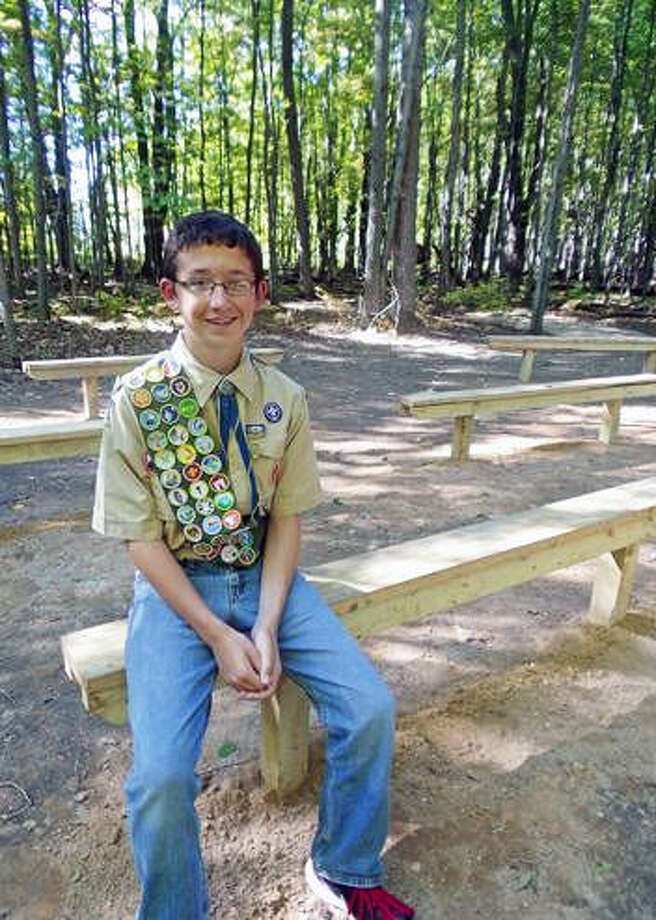 Peter T. DeRoche is shown seated in the outdoor classroom Photo: Photo Provided