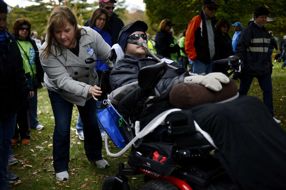 Midland residents Jennifer Schaun, left, and her husband Mike officially start the ALS of Michigan's Walk 'n Roll for ALS on Sunday at Emerson Park. Photo: NICK KING | Nking@mdn.net