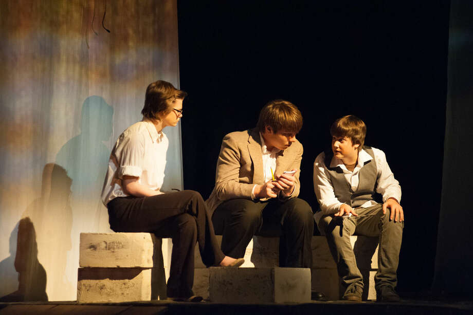 """Alainah Saint Onge performs as Dupin, Evan Sherwood as Daignault and Zach Swinson as Prefect in the Bullock Creek High School Theatre Club production of """"An Evening With Edgar Allen Poe,"""" which opens tonight Photo: STEVEN SIMPKINS 