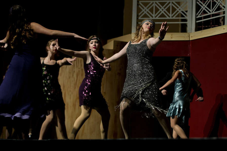 """Sophia Bagnall, right, who plays the part of Jordan Baker, dances on stage with other cast members during a dress rehearsal for Midland High's production of """"The Great Gatsby"""" on Monday at the Central Auditorium. The show opens on Thursday and continues on Friday and Saturday. All shows are at 7 p.m. Photo: NICK KING 