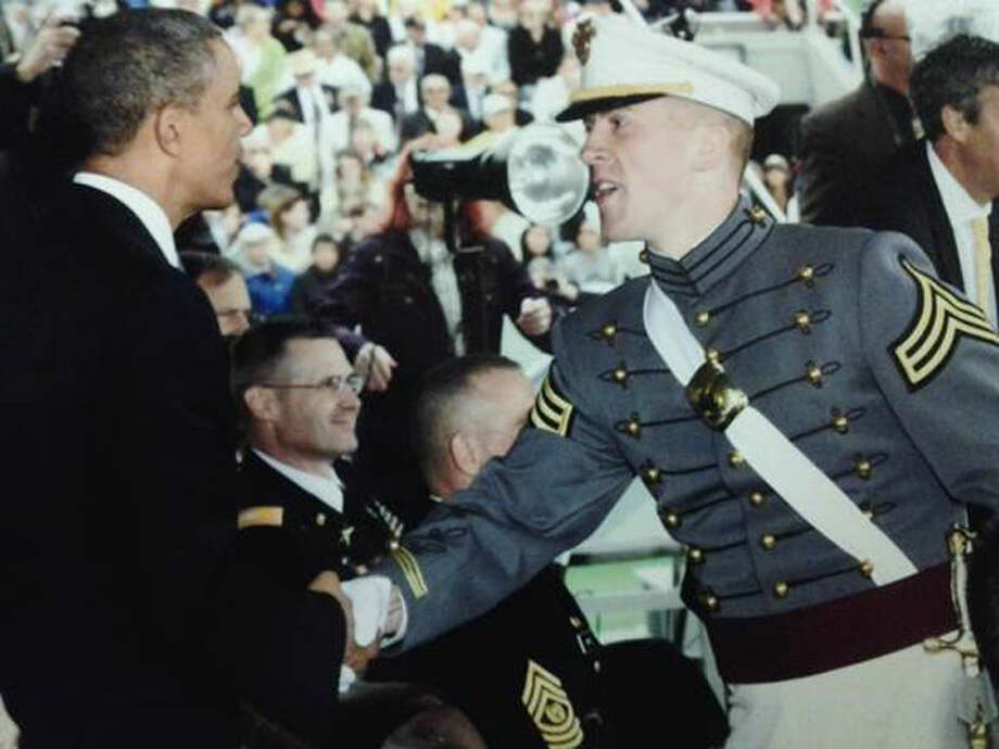 Cadet Garrett Thomas Kastl and President Barack Obama during graduation ceremonies in Michie Stadium at the U.S. Military Academy. President Obama delivered the commencement address to the graduating class of 2014. His brother, Captain Cory Kastl, administered the Oath of Office to Cadet Kastl during the commissioning ceremony in Cullen Hall at the U.S. Military Academy.
