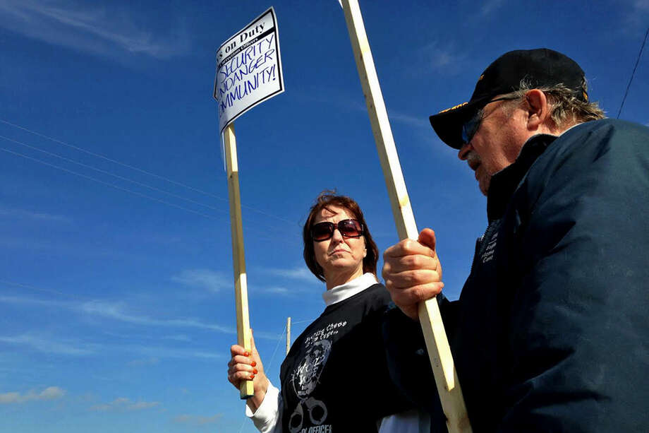 Pamela Drew who works at Carson City Correctional and Don Kimble of Saginaw, who retired from the Saginaw Regional Correctional faculty in Freeland protest cuts to staffing in Freeland on Wednesday. Photo: NEIL BLAKE | Nblake@mdn.net