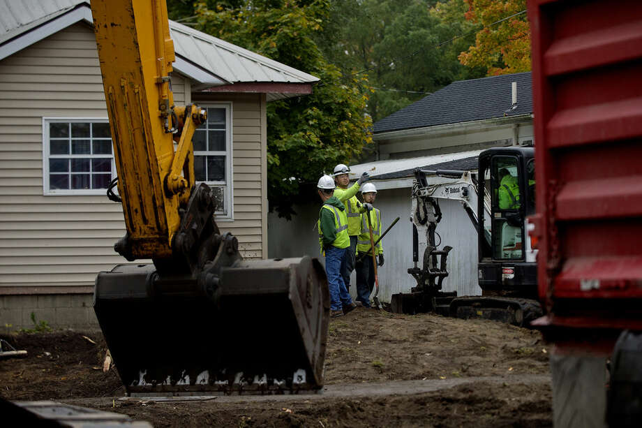 Crews work to remediate residential properties on Monday in St. Louis. Photo: NICK KING | Nking@mdn.net