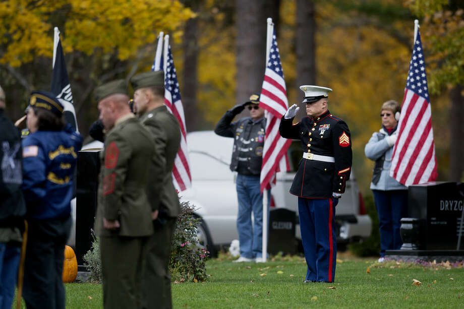 A Marine salutes at the Midland Municipal Cemetery at the burial ceremony of Lance Cpl. Steven Szymanski on Wednesday. Szymanski, of Midland, died on Tuesday, Oct. 21, at Fort Bragg, N.C., in a vehicular accident. Photo: NEIL BLAKE | Nblake@mdn.net