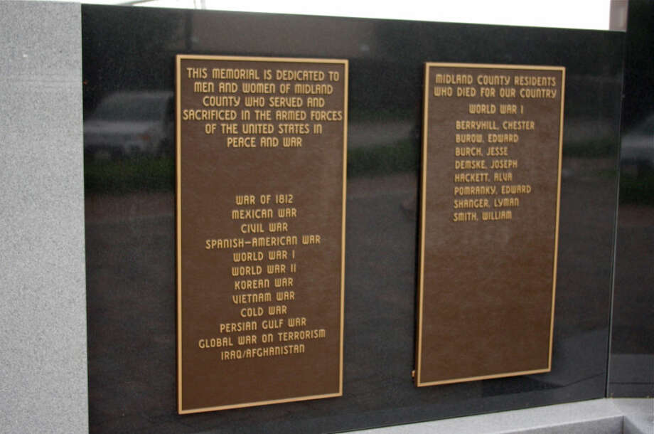 The Midland County Veterans Memorial near the Midland County Courthouse includes recognition of eight service members who died during World War I. Among them is Lyman Shauger, whose name was spelled Shanger years ago on the memorial panel. Photo: STUART FROHM | For The Daily News