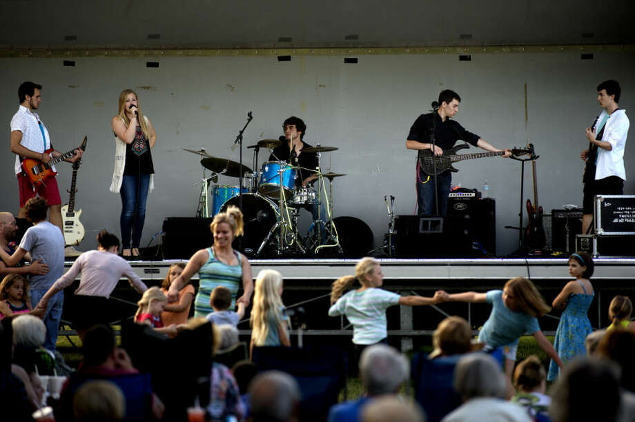 The band Loose Change, from left, Jimmy Bergmooser, 18, Abby Drumright, 17, Elliott Miller, Nick Shahin, both 18, and Tristayn Owen, 16, perform for the crowd during Tunes by the Tridge. Photo: NICK KING | Nking@mdn.net