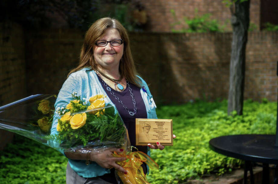 Teresa Wakeman of Midland was recently recognized for her dedication and compassion to patients during a ceremony in which she was named this year's recipient of the Bernard E. Lorimer Award for MidMichigan Medical Center-Midland. Photo: Photo Provided