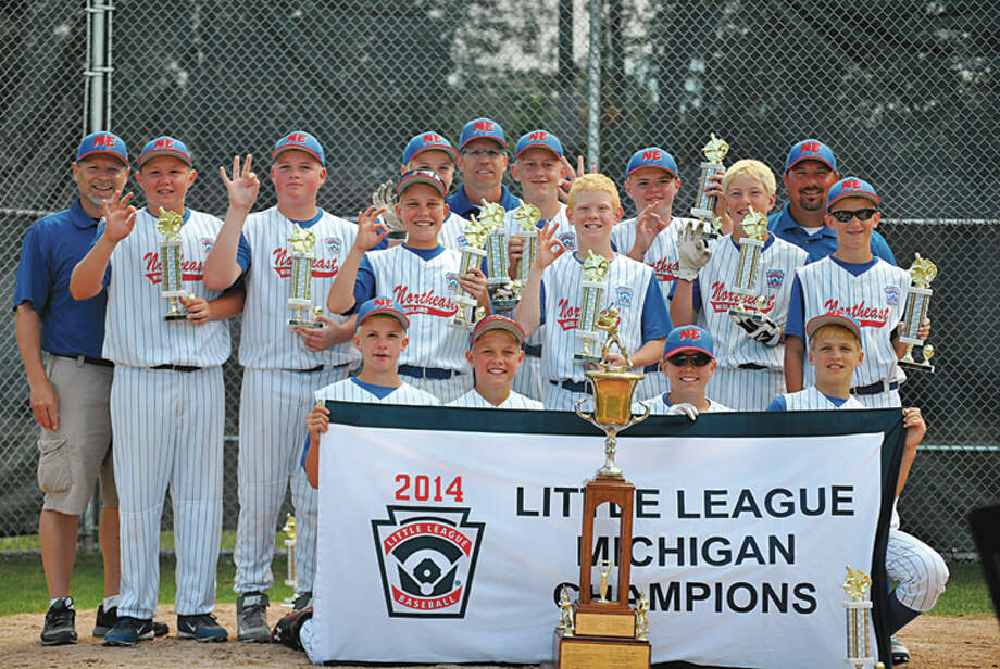 The Midland Northeast 11-12 all-stars pose with their state championship banner after beating Byron Township 6-5 in Wednesday's Little League baseball major state title game in Muskegon. Northeast will advance to play in the Great Lakes Regional in Indianapolis, Ind., next week. Photo: Photo Provided