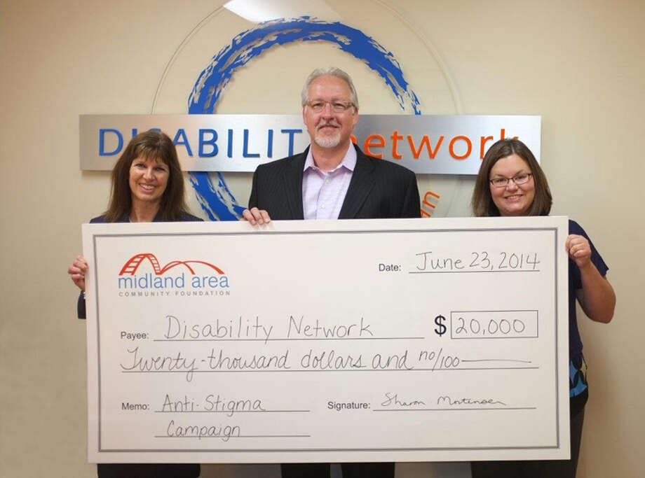 From left are Sharon Mortensen, Midland Area Community Foundation president and CEO; David Emmel, Disability Network of Mid-Michigan executive director; and Jennifer Page, who handles the Disability Network of Mid-Michigan's business and community relations. Photo: Photo Provided