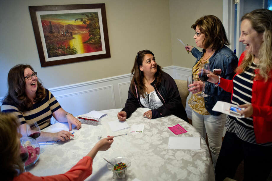 From left, Julie Arthur, Mary Koaches, Nazy Burnside, Carina Hjalber and Jo Bolland interact while playing Bunko with friends recently at friend Deepa Thomas' Midland home. Photo: NICK KING | Nking@mdn.net