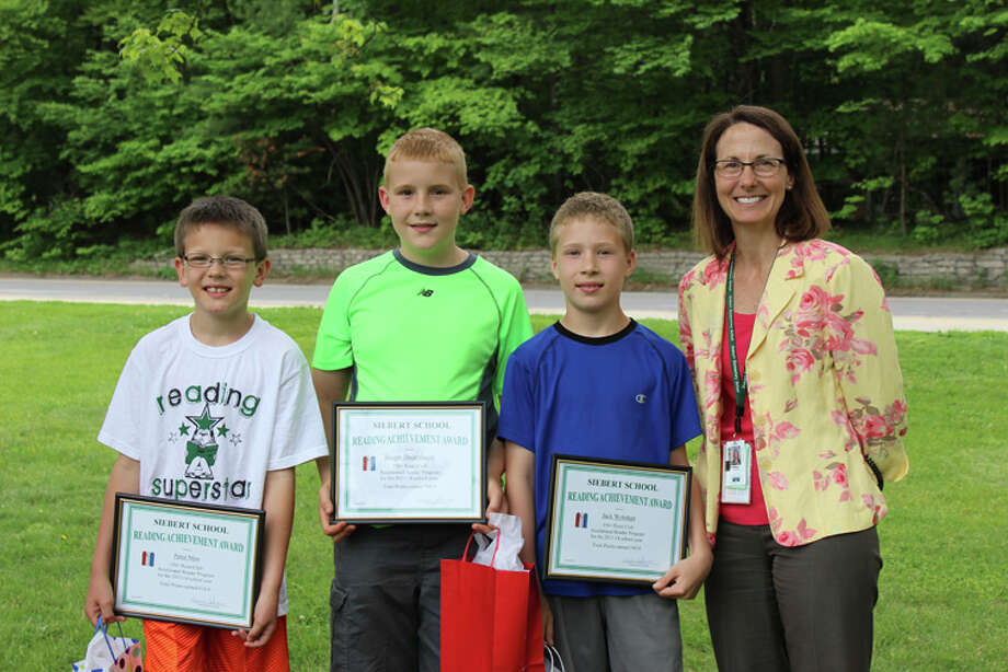 Siebert Top Readers Peter Mon, Joseph Dauenhauer and Jack Wolohan are congratulated by Siebert Principal Susan Johnson. Photo: Photo Provided