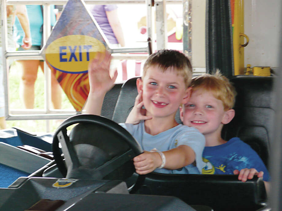 Brothers Sam (left) and Ben Maxwell of Midland enjoy the bumper car rides a few years ago at the Auburn Cornfest. Kids having fun at the annual event is a picture to behold for festival organizers like Russ Williams and Erin Poltorak, who along with their fellow committee members have been working hard in recent years to stage a more family friendly event. Photo: Photo Provided