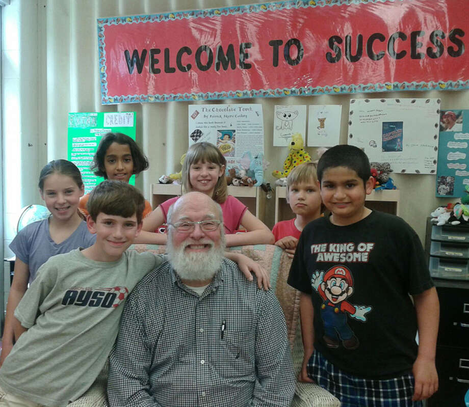 Michigan author Jeffery Schatzer poses for a picture with Siebert Elementary fourth grade students during a recent visit to the school. Photo: Photo Provided
