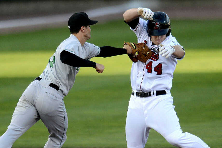 Loons' Joey Curletta, right, is tagged out by LumberKings' Jack Reinheimer after Curletta was caught in a pickle in the fourth inning Wednesday at Dow Diamond. The LumberKings won 5-0. Photo: NICK KING   Nking@mdn.net