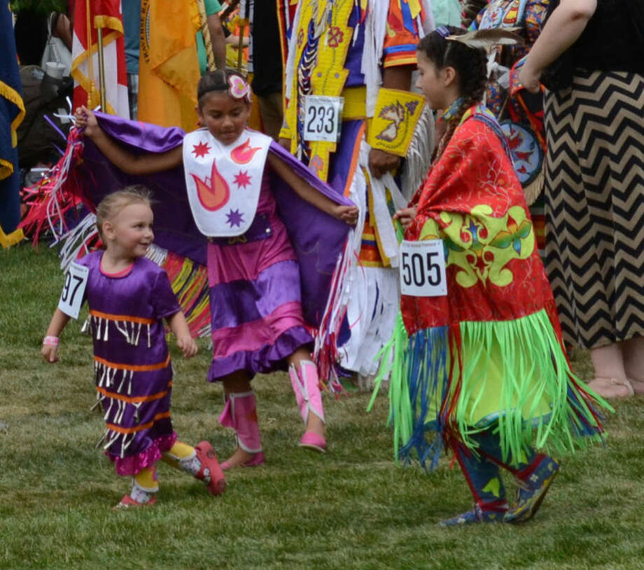 Children dance at the 30th annual Saginaw Chippewa Tribal Powwow. More than 700 people competed during the traditional dances. Photo: KATHERINE RANZENBERGER | For The Daily News