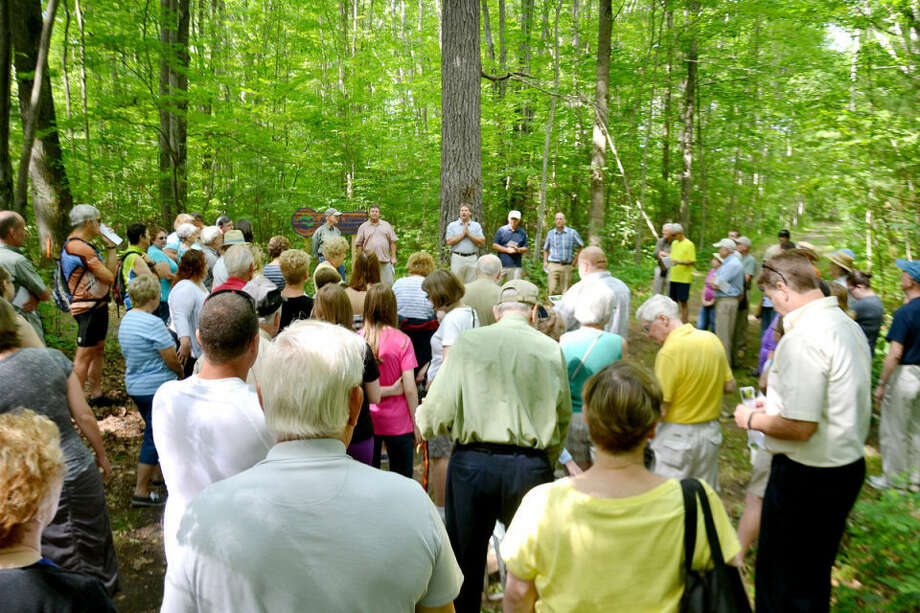 Doug Koop (in middle, with hands together), executive director of the Little Forks Conservancy, speaks to a crowd gathered in the Pine Haven Recreation Area for the dedication of the Conservancy's Albert and Virginia Szok Preserve. Photo: STEVE GRIFFIN | For The Daily News