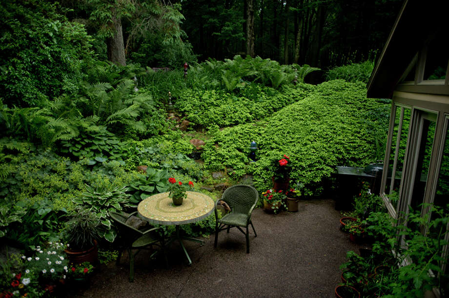 The patio at the Mathieu house is nestled in the garden. / Midland Daily News