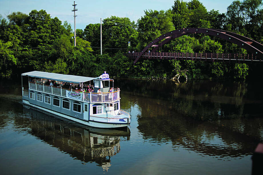 NICK KING | nking@mdn.net The Grand Princess Riverboat makes it's way toward the Tridge during a ride on Friday evening during River Days. Photo: Nick King/Midland  Daily News