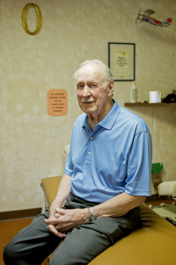 Chiropractor John M. Ostergren, 89, has been practicing for 65 years and still sees patients out of his office in Midland. Photo: NEIL BLAKE | Nblake@mdn.net