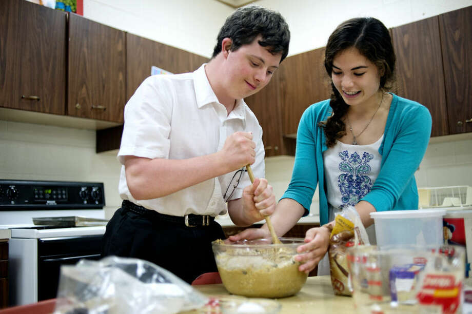 Dow High School junior Jasmine Purtell, right, and senior Alex Brown work on making cookie batter during a Cooking Matters class recently at the school. Photo: NICK KING | Nking@mdn.net