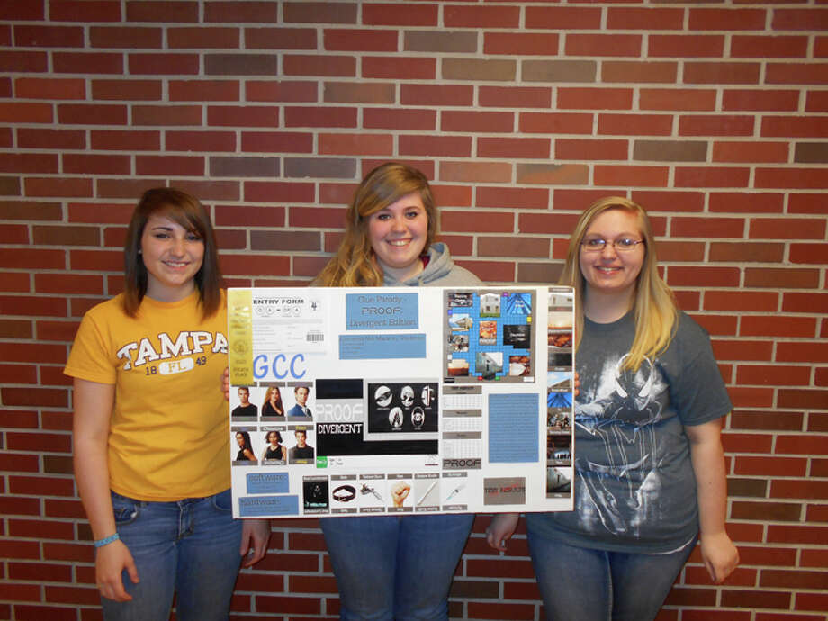 A group project by Gladwin High School students (from the left) Mercedez Hisey, Calie Nixon and Katie Loesel placed fourth at the 2014 Michigan Industrial and Technology Education Society (MITES) State Convention and Student Competition. Photo: Photo Provided