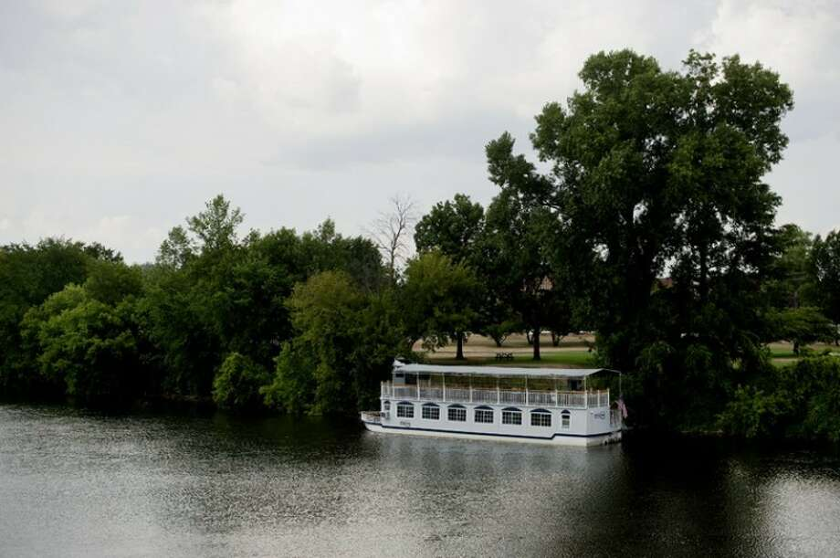 NICK KING | nking@mdn.net The Grand Princess river boat sits docked in the Tittabawassee River at Chippewassee Park on Tuesday. The river boat was delivered to Midland on Tuesday as the Midland Area Community Foundation prepares for Riverdays. Photo: Nick King/Midland  Daily News