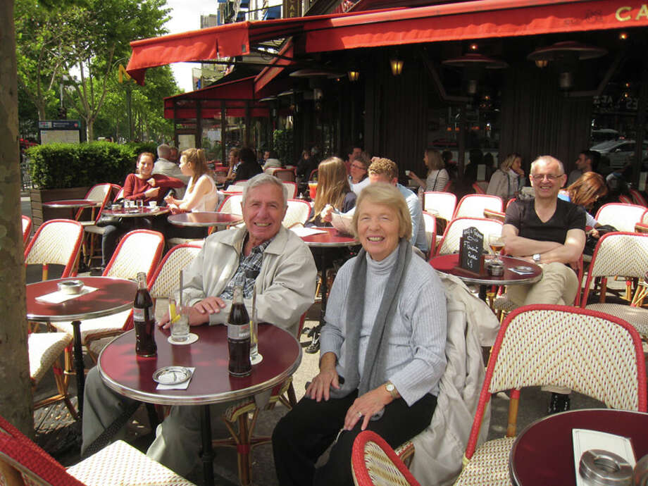 The author and her husband enjoy a cafe in France.