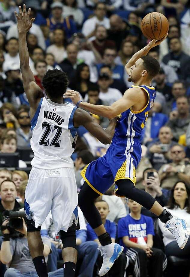 Golden State Warriors' Stephen Curry, right, goes up for a shot as Minnesota Timberwolves' Andrew Wiggins defends in the first quarter of an NBA basketball game Monday, March 21, 2016, in Minneapolis. (AP Photo/Jim Mone) Photo: Jim Mone, AP