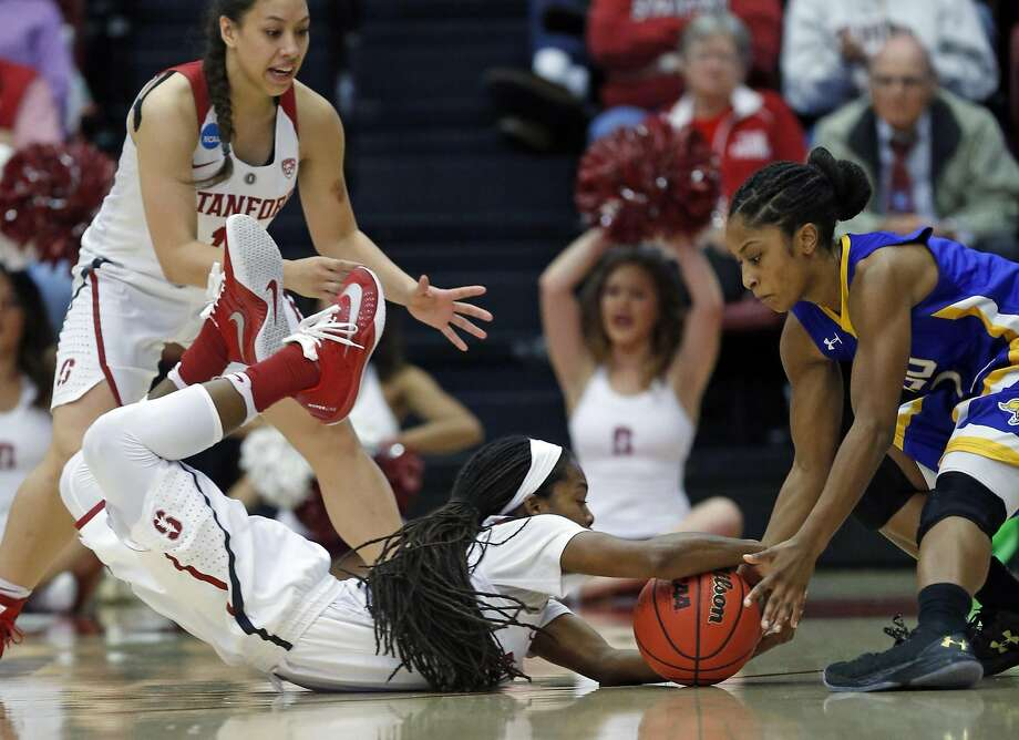 Stanford's Lili Thompson dives for a ball against South Dakota State's Alexis Alexander in 2nd quarter during 2016 NCAA Division 1 Women's Basketball Tournament game in Stanford, Calif., on Monday, March 21, 2016. Photo: Scott Strazzante, The Chronicle