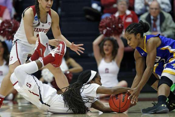 Stanford's Lili Thompson dives for a ball against South Dakota State's Alexis Alexander in 2nd quarter during 2016 NCAA Division 1 Women's Basketball Tournament game in Stanford, Calif., on Monday, March 21, 2016.